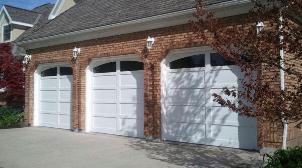 three white carriage house garage doors