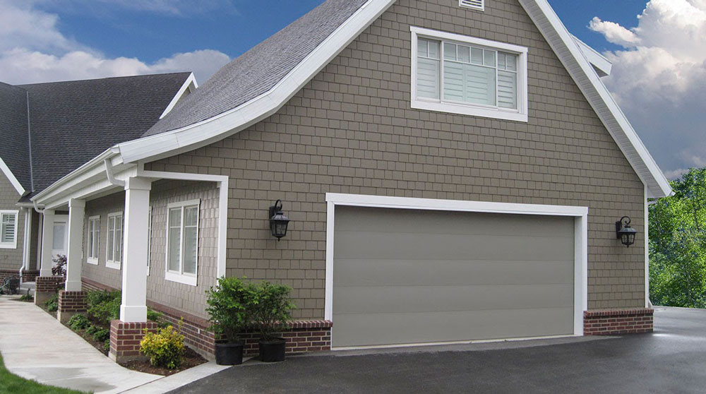 modern gray home with gray garage