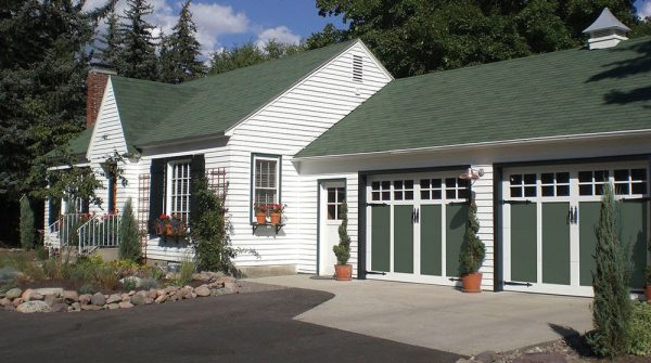 green and white design carriage house garage doors