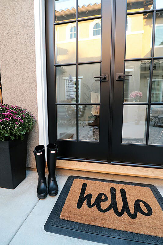 Entrance door with 'Hello' sign