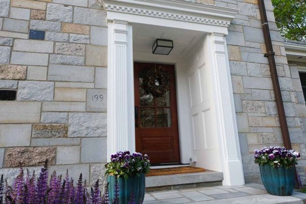 House entrance with brown door